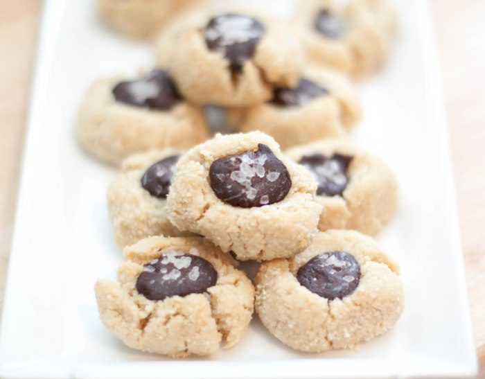a plate of chocolate thumbprint cookies with salt